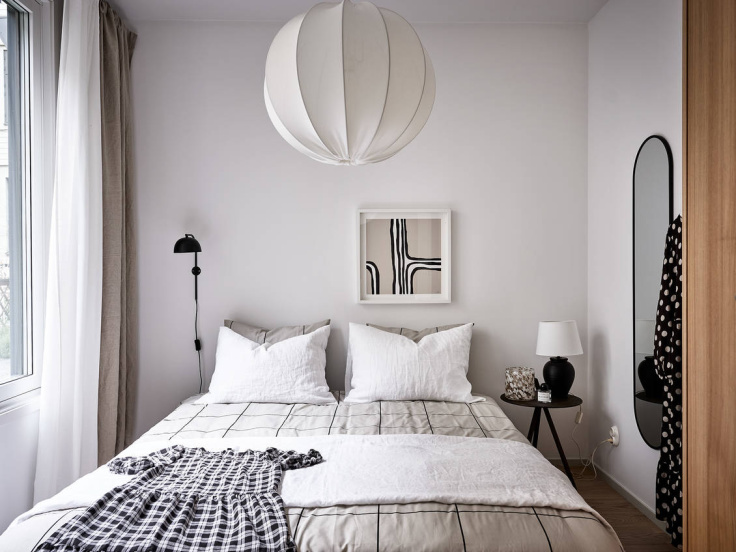 minimal nordic bedroom with graphic patterns